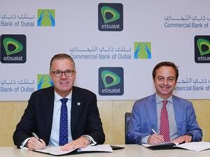 Dr. Bernd van Linder, Chief Executive Officer of Commercial Bank of Dubai, and Antonio Ricciardi, SVP, Consumer Intelligence and Engagement, Etisalat, at the signing ceremony held at the CBD headquarters in Dubai.