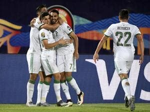 Algeria will face either Ivory Coast or Mali in the Africa Cup of Nations last eight after seeing off Guinea in comfortable fashion.