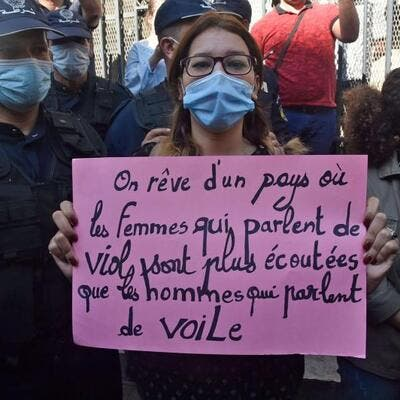 "An Algerian activist holds a placard reading in French, ""We dream of a country where women who talk about rape are listened to more than men who talk about the veil"" during a rally in the capital Algiers, this month. (AFP)"