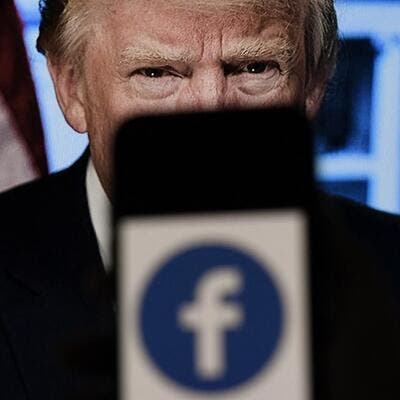 In this file photo illustration, a phone screen displays a Facebook logo