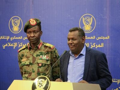 Spokesman of the Sudan's Transitional Military Council Lieutenant General Shamseddine Kabbashi (L) looks on as Sudanese protest leader Madani Abbas Madani speaks during a press conference in Khartoum on May 20, 2019. (AFP)