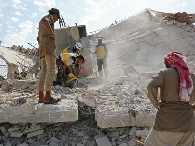 Members of the Syrian Civil Defence (White Helmets) search for victims amidst the rubble of a building that collapsed during reported air strikes by pro-regime forces in the village of Beinin, north of Maaret al-Numan, in the northern Idlib province, on August 20, 2019. (AFP/ File Photo)