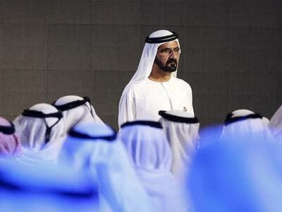 Dubai ruler Sheikh Mohammed bin Rashid al-Maktoum unveils the United Arab Emirates' mission to Mars on May 6, 2015 (AFP Photo/KARIM SAHIB)