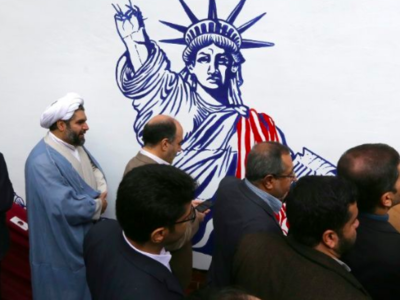 Iran unveils new anti-American murals on the walls of the former US embassy as Tehran prepares to celebrate the 40th anniversary  of the American hostage taking (AFP)