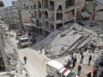 Members of the Syrian Civil Defense search the rubble of a collapsed building following an explosion in the town of Jisr al-Shughuor in Idlib, Syria on April 24, 2019. (AFP)