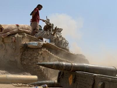 A fighter loyal to Yemen's separatist Southern Transitional Council (STC) stands atop a tank amid clashes with Saudi-backed government forces for control of Zinjibar, the capital of the southern Abyan province, in the Sheikh Salim area on May 23, 2020. Nabil HASAN / AFP