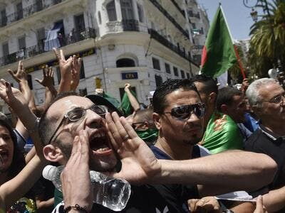 Algerian protesters shout anti-system slogans during the weekly Friday demonstration in the capital Algiers on June 21, 2019. (AFP)