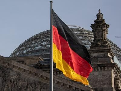 The German flag flys outside the Reichstag, the building which houses the Bundestag (the German lower house of parliament) on February 24, 2021 in Berlin. David GANNON / AFP