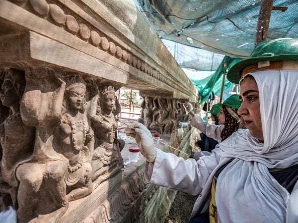 "Archaeologists work on restoring relief sculptures at the historic ""Le Palais Hindou"" (also known as the ""Baron Empain Palace"") built by in the early 20th century by Belgian industrialist Edouard Louis Joseph, Baron Empain, in the classical Khmer architectural style of Cambodia's Angkor Wat, in the Egyptian capital Cairo's northeastern Heliopolis district on August 18, 2019.  Khaled DESOUKI / AFP"