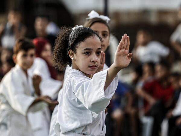 Young Palestinian karatekas demonstrate their skills during a Karate promotion ceremony at a sporting centre in the Rafah camp for Palestinian refugees in the southern Gaza Strip on September 20, 2019. SAID KHATIB / AFP