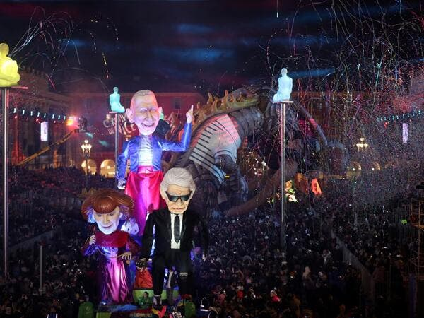 Giant figures depicting German fashion designer Karl Lagerfeld (R), and French fashion designers Sonia Rykiel (L) and Jean-Paul Gaultier are seen during the 136th Nice Carnival parade in Nice, southeastern France, on February 15, 2020. The Carnival takes place until February 29, 2020 on the theme 'King of Fashion'. VALERY HACHE / AFP
