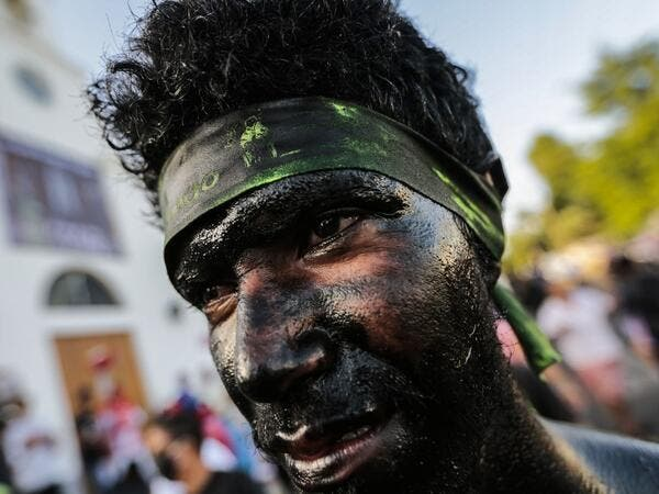 A Catholic faithful smeared in burnt oil takes part in the opening of the ten-day celebration of the Santo Domingo de Guzman festival, outside the Las Sierritas de Santo Domingo church in Managua, on August 1, 2020 amid the COVID-19 novel coronavirus pandemic. Despite the Catholic Church cancelling all religious activities due to the coronavirus pandemic, devotees gathered outside the church for the celebration. Inti OCON / AFP