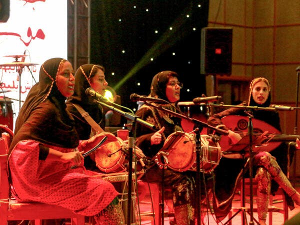 "Members of the Iranian all-women music band ""Dingo"" (L to R) Malihe Shahinzadeh, Negin Heydari, Faezeh Mohseni, and Noushin Yousefzadeh perform together at a concert during the state-organised ""Persian Gulf music"" festival at Avini Hall in Iran's southern Gulf port city of Bandar Abbas on April 29, 2019. ATTA KENARE / AFP"