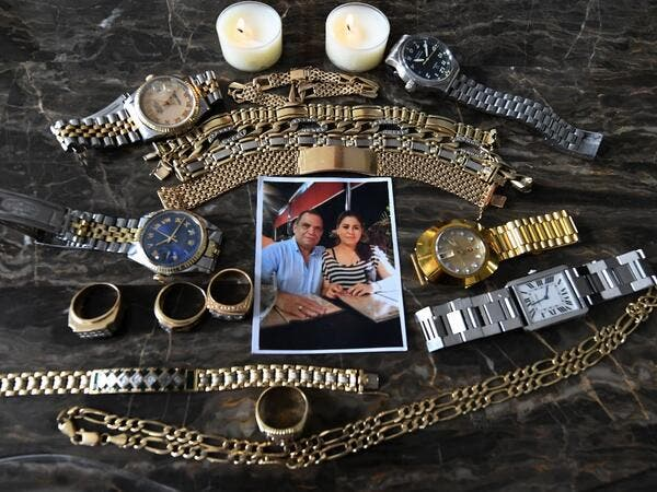 Picture of a photo and jewellery which belonged to Honduran journalist David Romero, head of Globo radio and TV station, who died of complications from the novel coronavirus COVID-19 on July 18, taken at his house in Tegucigalpa, on July 22, 2020. Global deaths from the coronavirus have almost reached on September 25, 2020 the grim threshold of one million. Around one-third of fatalities were in Latin America, where countries with overstretched medical resources are preparing for a further onslaught. Orland