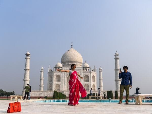Tourists visit the Taj Mahal in Agra on September 21, 2020. The Taj Mahal reopened to visitors on September 21 in a symbolic business-as-usual gesture even as India looks set to overtake the US as the global leader in coronavirus infections. Sajjad HUSSAIN / AFP