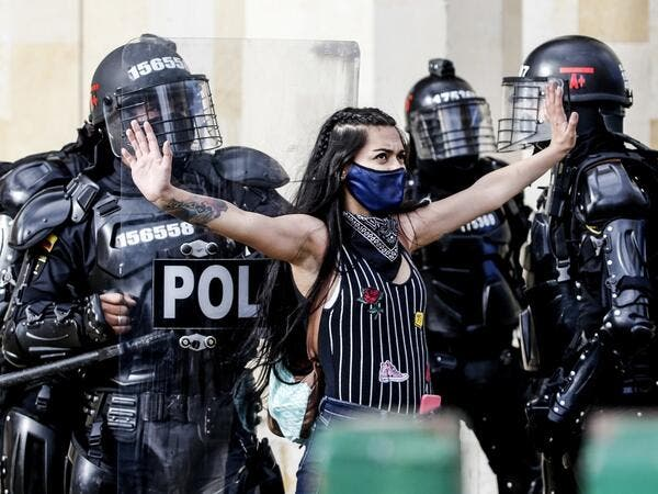 Riot police detain a demonstrator during protests against police brutality in Bogota on September 21, 2020. Large groups of protesters are mobilizing in Colombia against police violence and in rejection of the government, after the bloody protests that unleashed the recent murder of a man at the hands of two uniformed men. LEONARDO MUNOZ / AFP
