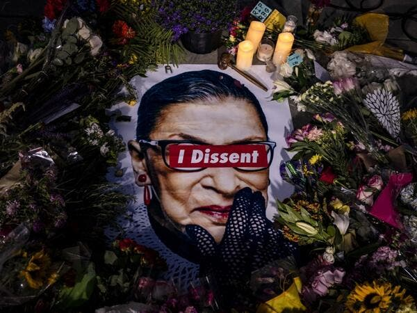 People left mementos in a makeshift memorial for Supreme Court Justice Ruth Bader Ginsburg in front of the US Supreme Court on September 19, 2020 in Washington, DC. Justice Ginsburg has died at age 87 after a battle with pancreatic cancer. Samuel Corum/Getty Images/AFP Samuel Corum / GETTY IMAGES NORTH AMERICA / Getty Images via AFP