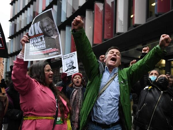 Supporters of Wikileaks founder Julian Assange celebrate outside the Old Bailey court in central London after a judge ruled that Assange should not be extradited to the United States to face espionage charges for publishing secret documents online on January 4, 2021. DANIEL LEAL-OLIVAS / AFP