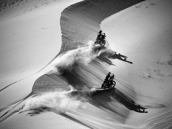 Australian biker Toby Price (top) and Argentinian biker Kevin Benavides compete during Stage 4 of the Dakar Rally 2021 between Wadi Ad-Dawasir and Saudi Arabia's capital Riyadh, on January 6, 2021. FRANCK FIFE / AFP