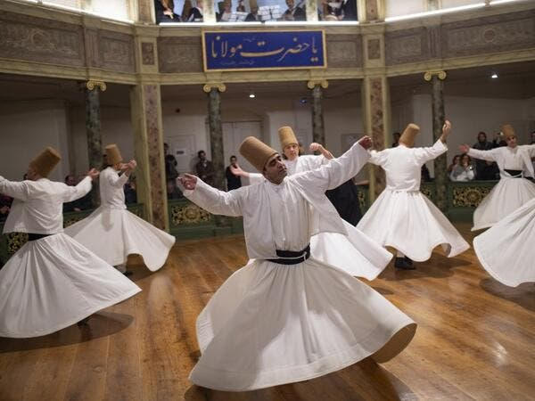 Whirling dervishes perform during a ceremony marking the anniversary of the death of Jelaleddin Mevlana Rumi, Sufi mystic, poet and founder of sufism on December 16, 2018 at Galata Mevlihanesi in Istanbul. Yasin AKGUL / AFP