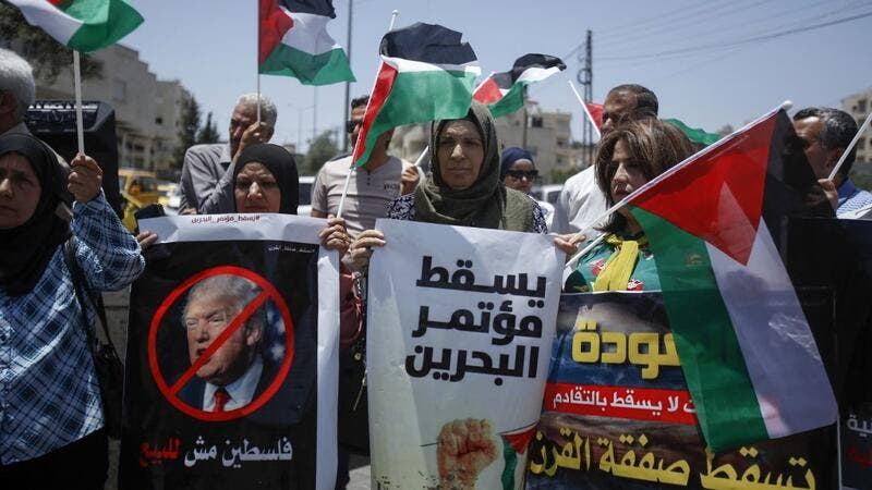 Palestinians hold banners and shout slogans as they rally against the US-led Israeli-Palestinian peace conference in Bahrain scheduled for next week, in Bethlehem in the occupied West Bank on June 20, 2019. (AFP/ File Photo)