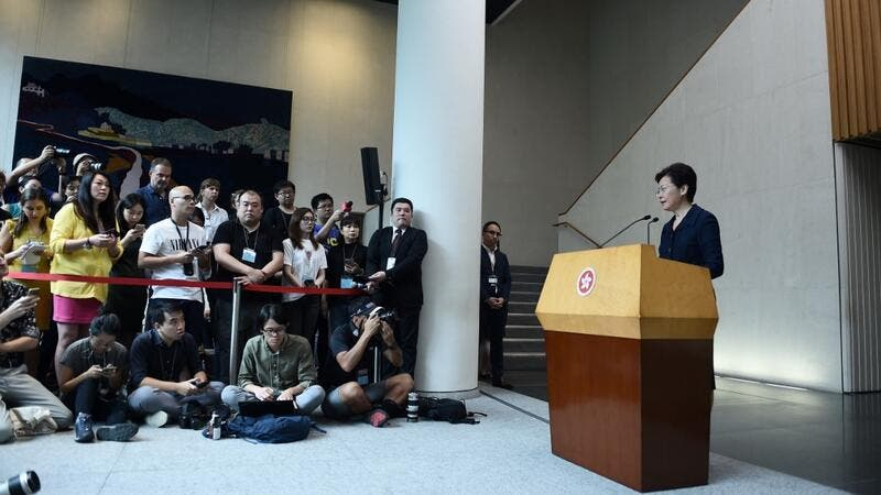 Hong Kong Chief Executive Carrie Lam (R) speaks at a press conference in Hong Kong on August 20, 2019. (Lillian SUWANRUMPHA / AFP)