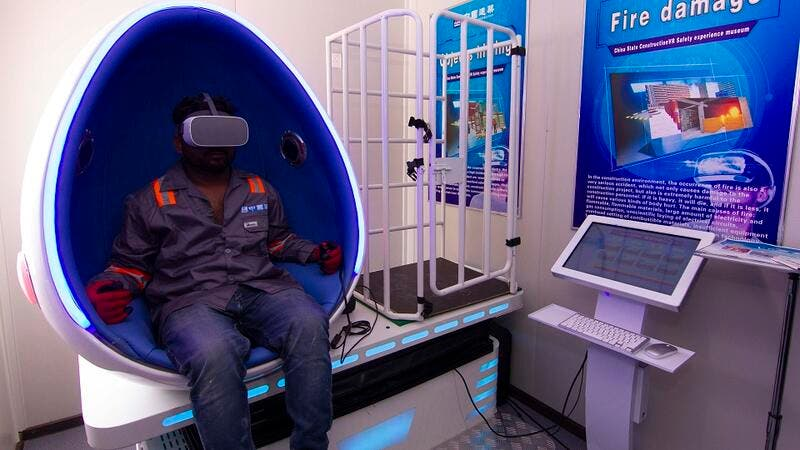 Construction workers experience simulated hazard - management training in the Virtual Reality Pods at DAMAC's AYKON City.