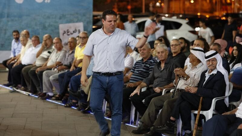 The head of the mainly Arab Joint List alliance Ayman Odeh gestures to supporters during an electoral campaign rally in the northern Arab-Israeli town of Sakhnin on September 15, 2019. (AFP/ File Photo)