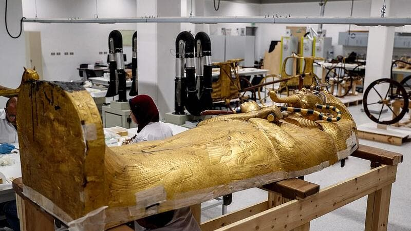 The sarcophagus, a box-like stone container, held three coffins for the body of the king. The outer coffins (pictured) were crafted in wood and covered in gold with the innermost coffin made of solid gold. (AFP/ File Photo)