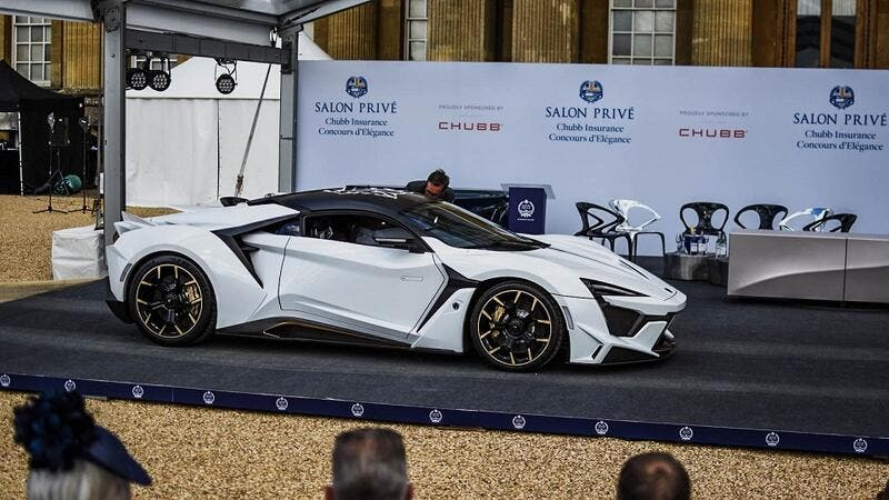 The Fenyr SuperSport was presented in Arctic white with gold accents and drew crowds with its dynamic lines
