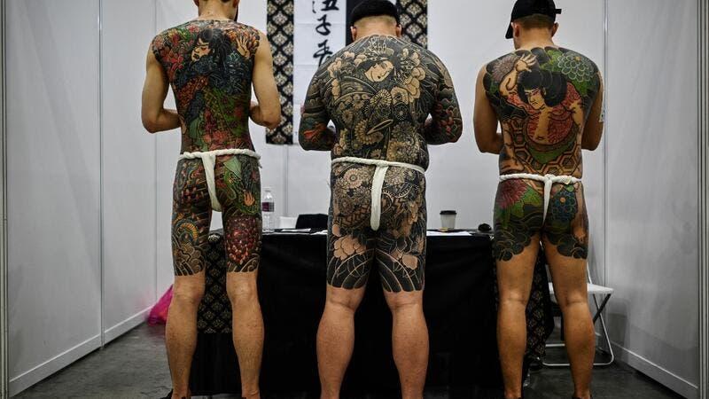 Malaysia Slams Tattoo Expo Over Half-Naked Pics, Gets