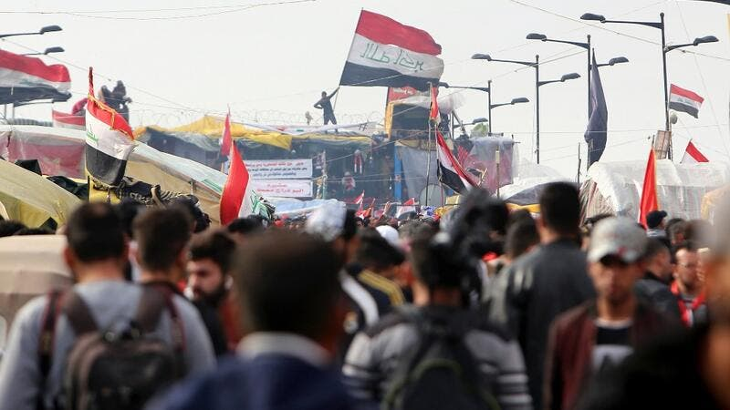Iraqis gather at al-Sinek bridge in the capital Baghdad amid ongoing anti-government protests on December 10, 2019. SABAH ARAR / AFP