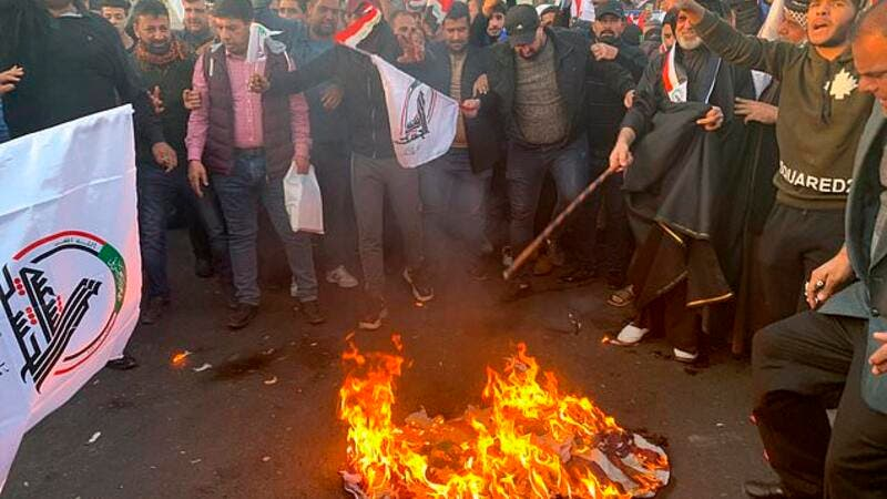 Protesters set fire to the outside walls of the US Embassy in Baghdad (Twitter)