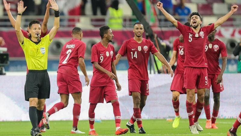Qatar players cheer as Japanese referee Ryuji Sato signals the end of the 24th Arabian Gulf Cup Group A football match between Qatar and the United Arab Emirates at the Khalifa International Stadium in the Qatari capital Doha on December 2, 2019. KARIM JAAFAR / AFP