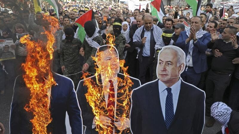 In this file photo taken on November 26, 2019, Palestinian protesters burn cardboard cutouts of US President Donald Trump, State Secretary Mike Pompeo, and Israeli Prime Minister Benjamin Netanyahu, during a demonstration in the center of Nablus in the occupied West Bank. (AFP/ File Photo)