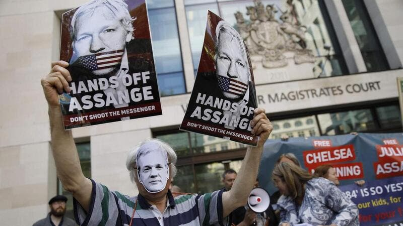 Supporters of WikiLeaks founder Julian Assange gathered outside Westminster Magistrates Court to support him. AFP