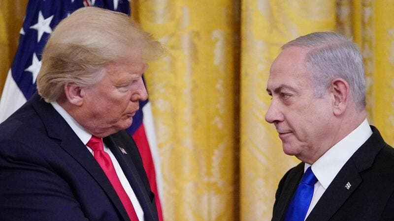 US President Donald Trump and Israel's Prime Minister Benjamin Netanyahu take part in an announcement of Trump's Middle East peace plan in the East Room of the White House in Washington, DC on January 28, 2020. AFP