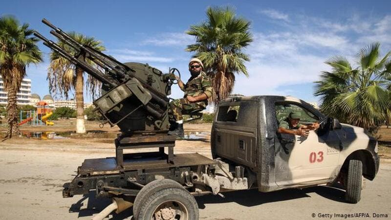 Libyan National Army forces stand guard in Benghazi. (AFP)