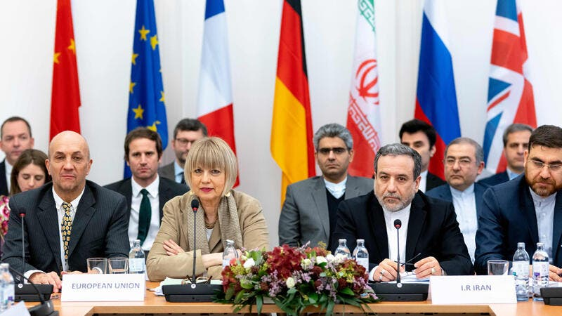 Iranian political deputy at the Ministry of Foreign Affairs of Iran Abbas Araghchi (C-R) and German Secretary General of the European External Action Service Helga Maria Schmid (C-L) attend a meeting of the Joint Commission on Iran's nuclear program. (JOE KLAMAR/AFP/GETTY IMAGES)