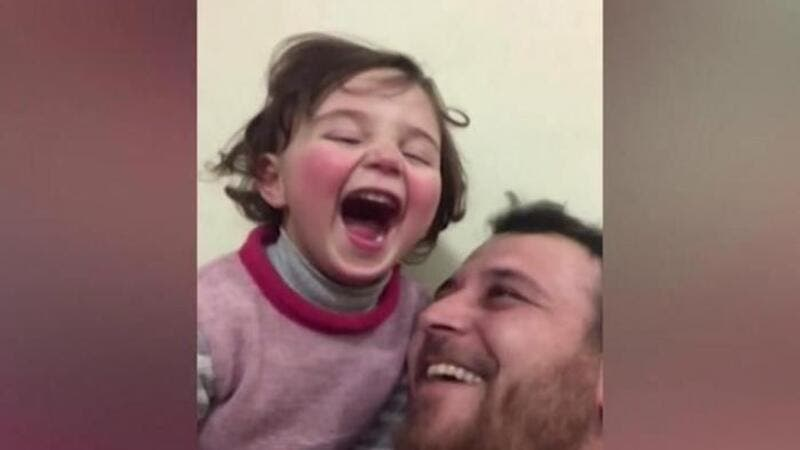 'Laugh at the Fireworks!' Syrian Father Makes Up a Game to Comfort His Daughter as Bombs Fall