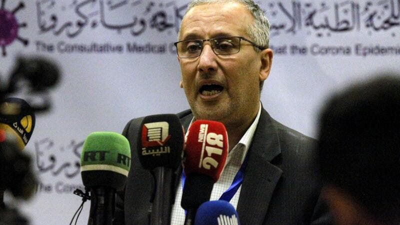 Ahmed al-Hassi, spokesman for the medical committee to combat COVID-19 coronavirus disease in Libya's eastern city of Benghazi, speaks during a press conference on March 20, 2020 announcing updates on figures for suspected cases. Abdullah DOMA / AFP