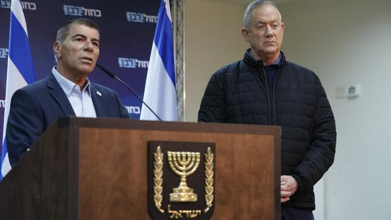 In this file photo taken on February 24, 2020, leader of Israel's Blue and White electoral alliance Benny Gantz (R) listens to Gabi Ashkenazi (L), member of the Blue and White electoral alliance, as he speaks during a press conference in the southern Israeli town of Sderot on the border with Gaza. Former Israeli army chief Gabi Ashkenazi, who spent nearly four decades in the military, will be nominated as Israel's next foreign minister, his Blue and White political alliance said on May 13. Jack GUEZ / AFP