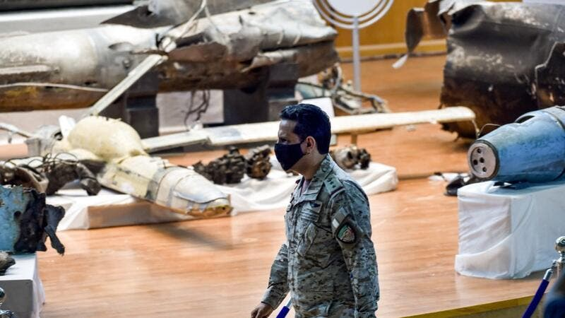 Royal Saudi Air Force Colonel Turki bin Saleh al-Malki walks past alleged Iranian weapons seized by Saudi forces from Yemen's Huthi rebels, ahead of a press conference at the Armed Forces Oficers club in Saudi Arabia's capital Riyadh on July 2, 2020, after air strikes on the rebel-held Yemeni capital. FAYEZ NURELDINE / AFP