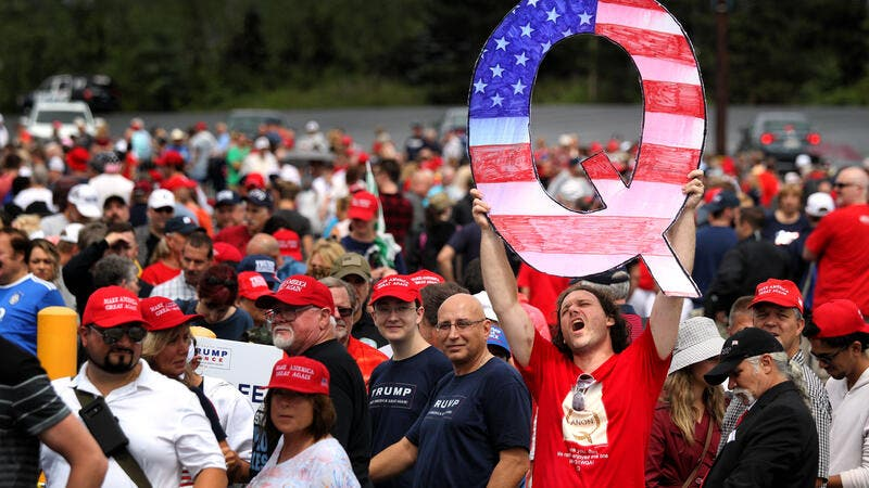Is QAnon Creeping Into US Congress and Police? Twitter Crackdown Highlights Group's Spread and Popularity