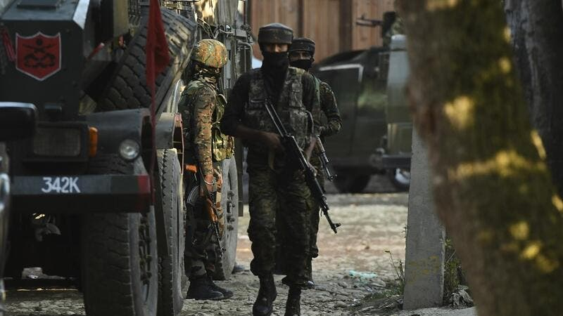 Indian army soldiers are seen during a cordon and search operation following reports of the presence of militants, at Kawoosa Khalisa area of Budgam district, in Srinagar on September 7, 2020. Tauseef MUSTAFA / AFP