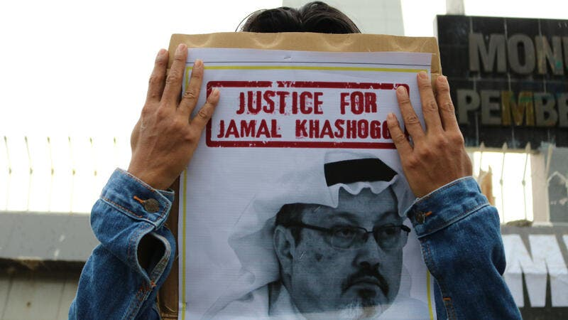 Humanitarian activists hold a poster with a picture of Jamal Khashoggi demonstrating in Makassar. (Shutterstock/ File Photo)