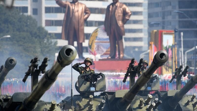 "In a file photo taken on September 9, 2018 Korean People's Army (KPA) soldiers salute as they ride tanks during a military parade and mass rally on Kim Il Sung square in Pyongyang. All eyes will be on North Korea October 10, 2020 as it celebrates the 75th birthday of the ruling Workers' Party, with speculation mounting for a ""big event"" showcasing the nuclear-armed nation's military strength.  Ed JONES / AFP"