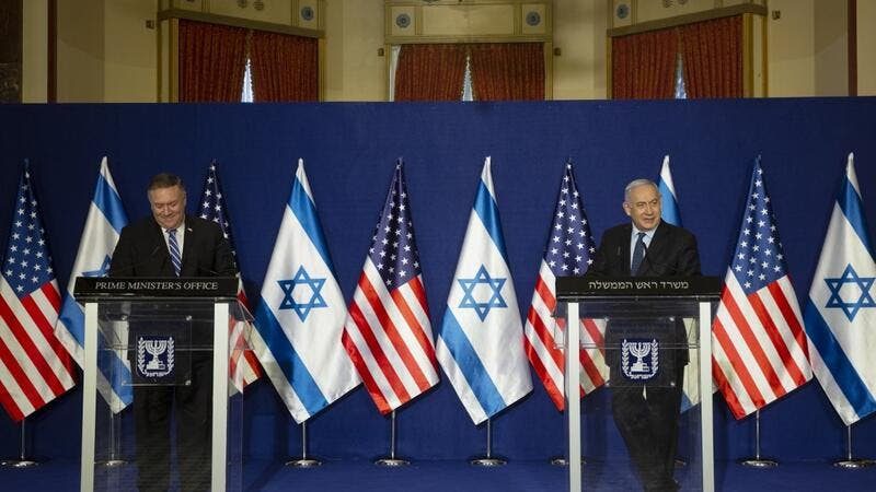 US Secretary of State Mike Pompeo, L, and Israeli Prime Minister Benjamin Netanyahu make a joint statement after meeting in Jerusalem on November 19, 2020. Maya ALLERUZZO / POOL / AFP