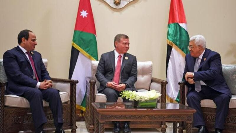His Majesty King Abdullah meets with Egyptian President Abdel Fattah Al Sisi and Palestinian President Mahmoud Abbas on the sidelines of the Arab summit at the Dead Sea on Wednesday (AFP photo)