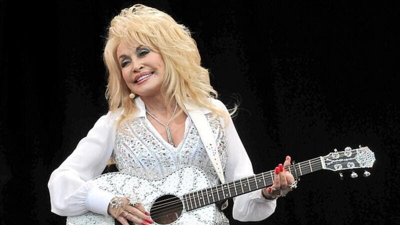 Dolly Parton marks 75th birthday with 'call for kindness'